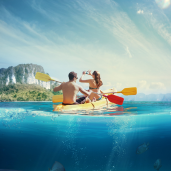 Two people kayaking in the sea
